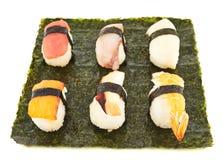 Nigirizushi sushi over nori sheet Stock Photography