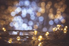 The night light bokeh festival with small LED light decor on party night christmas or new year background