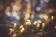 The nigt light bokeh festival with small LED light decor on party night christmas or new year background