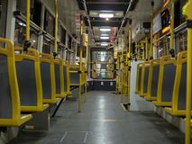 Nigt travel in the empty tram. Interior perspective view from tram stock images