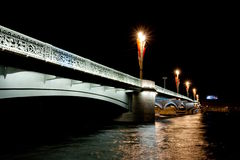 Nigth bridge in st.petersburg. Light nigth bridge in st.petersburg with dark water and black sky Stock Image