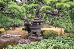 Beautiful stoned lanterns in nijo castle grounds , kyoto, kansai, Japan stock photo