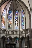 Nijmegen, The Netherlands, November 24, 2018 - Old stained glass. Windows in the Antonius van Padua kerk royalty free stock image
