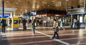 Nijmegen Railway Station Hall with people. Nijmegen, Netherlands - November 7, 2017: Hall of railway central station Nijmegen with travellers and shops Royalty Free Stock Photography
