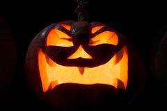 Nikczemna rzeźbiąca bania dla Halloween obrazy royalty free