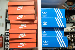 Nike and Adidas. Shoe boxes next to each other in a store Royalty Free Stock Photo