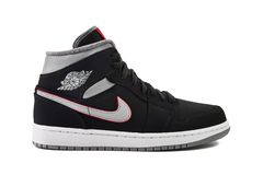 Nike Air Jordan 1 Mid black, grey, red and white sneaker stock photography