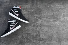 Nike Air Jordan 1 Mid black, grey, red and white sneakers royalty free stock image