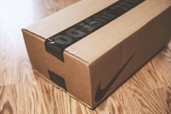 A Nike box on the floor royalty free stock image