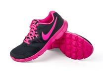 Nike-Dame - der Laufschuhe der Frauen Stockbild