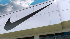 Nike Inscription And Logo On The Modern Building Facade. Editorial 3D Rendering Royalty Free Stock Photos