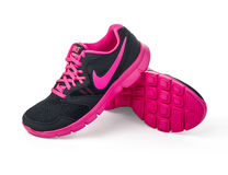 Nike lady's - women's running shoes. Chisinau, Moldova- May 27, 2015: Nike lady's - women's running shoes - sneakers - trainers, in gray and pink, showing the Stock Image