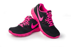 Nike lady`s - women`s running shoes. Chisinau, Moldova- May 27, 2015: Nike lady`s - women`s running shoes - sneakers - trainers, in gray and pink, showing the Royalty Free Stock Photography