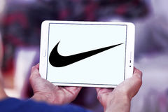 Nike logo. Logo of nike company on samsung tablet in hands royalty free stock images