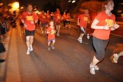 Nike NightRun Tel Aviv - de jongste deelnemer Stock Afbeeldingen