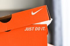 Nike running shoes box with Just Do It and nike logo on orange box in the store