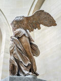 Nike of Samothrake. PARIS, FRANCE - AUGUST 28 2013: Winged Victory of Samothrace, also called Nike of Samothrace, marble sculpture exhibited in Louvre Museum Stock Images