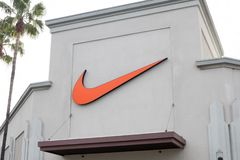 A Nike sign in front of the store royalty free stock images