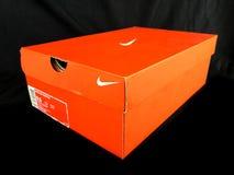 Nike Sneakers à vendre à un magasin de chaussures Photo stock