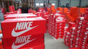 NIke sneakers boxes in warehouse. Serbia,March 2016. Nike sneakers boxes. Nike, multinational company. Product boxes shots. Photos are made in warehouse before royalty free stock images