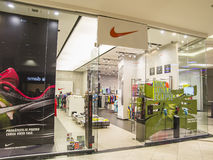 Nike Store. Entrance. Nike is a major publicly traded clothing, footwear, sportswear, and equipment supplier based in the United States. The company is Royalty Free Stock Images
