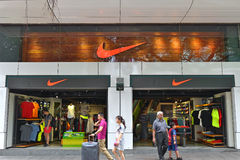 Nike Store. In Hong Kong. Nike is a major publicly listed supplier of clothing, sports shoes, sportswear, and equipment. The company is based in the United Stock Photo