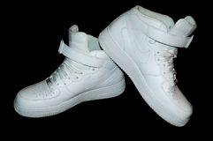 Nike White Sneakers en el negro Imágenes de archivo libres de regalías