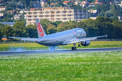 Niki Airbus A320. An Airbus A320 of Niki, a low cost airline in Austria, touches down at Innsbruck Airport Royalty Free Stock Photos
