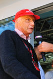 Nikki Lauda. Retired formula 1 Driver, Nikki Lauda is talking to the press during the Formula One at monza circuit, italy Stock Photography