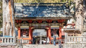 NIKKO, JAPAN - FEBRUARY 2, 2019: People walking to Omotemon Gate, the first gate at Toshogu Shrine. The shrine is final resting. Place of Tokugawa Ieyasu, the royalty free stock image