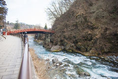 NIKKO, JAPAN - FEBRUARY 22, 2016 : water of stream flows through Royalty Free Stock Photos