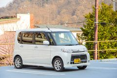 Nikko, Japan - March 31, 2015 : The mini van car brand `Daihatsu` parking in Nikko parking area in the morning.  Royalty Free Stock Photography