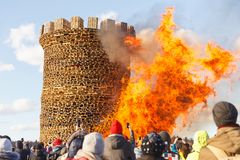 Nikola-Lenivets - March 9, 2019: Pancake week. Burning of the fortress of the Bastille royalty free stock image
