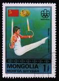Nikolai Andrianov Montreal spelar emblemet, USSR-flaggan, guldmedaljer, från `en för vinnare för serie`-guldmedaljen, circa 1976 Arkivfoto