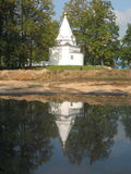 Nikolas-Ugreshskiy monastery. Santa-Nikolas-Ugreshskiy monastery in Russia, Moscow region. Landscape with little white chapel  and green trees on the bank of Royalty Free Stock Image