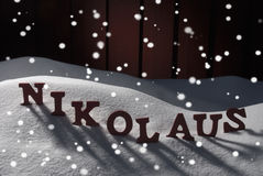 Nikolaus Means Santa Claus On Snow And Snowflakes Stock Images
