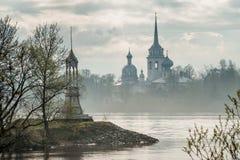 Nikolo Medvedsky Monastery in New Ladoga in foggy spring sunrise . Stock Photo