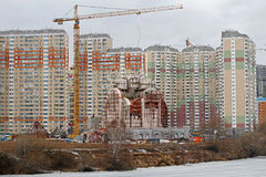 Nikolskaya church under construction on the background of residential buildings in Moscow Stock Photography