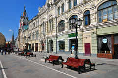 Nikolskaya street in Moscow, Russia. MOSCOW, RUSSIA - MAY 25: Wooden benches on Nikolskaya pedestrian street in Moscow on May 25, 2014. Nikolskaya is a renovated Stock Image
