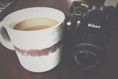 NIKON CAMERA AND COFFEE royalty free stock photography