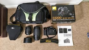 Nikon Camera Gear. Nikon camera kit with a D3200 body, two lenses, a bag and case, batteries, SD cards, manual and accessories. New photographer equipment stock photos