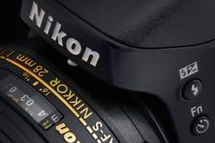 Nikon Camera with Lens. Warsaw, Poland - December 31, 2016: Digital SLR professional Nikon camera with Nikkor lens. Close-up view. Image in dark. Macro photo Royalty Free Stock Photo
