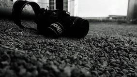 Nikon camera on pebbles