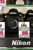 Nikon cameras. In a german shopping window - focus is on the logo on the bottom Royalty Free Stock Images