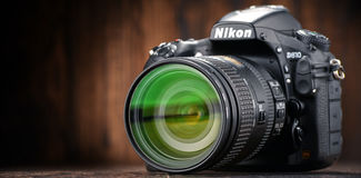 Nikon D810 camera with nikkor zoom. POZNAN, POLAND - JAN 20, 2017: Nikon is a Japanese multinational corporation headquartered in Tokyo, Japan, specializing in Royalty Free Stock Image
