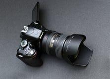 Nikon D5100 lens Nikkor 18-200. Black Nikon camera on a dark gray background royalty free stock images
