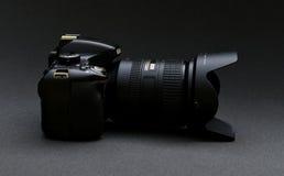 Nikon D5100 lens Nikkor 18-200. Black Nikon camera on a dark gray background Royalty Free Stock Image