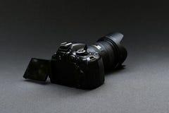 Nikon D5100 lens Nikkor 18-200. Black Nikon camera on a dark gray background Stock Photo