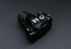 Nikon D5100 lens Nikkor 18-55. Black Nikon camera on a dark gray background Stock Images