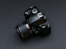Nikon D5100 lens Nikkor 18-55. Black Nikon camera on a dark gray background Stock Image